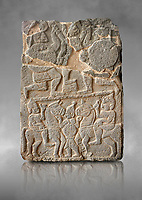 Pictures & images of the South Gate Hittite sculpture stele depicting Hittite Gods. 8th century BC. Karatepe Aslantas Open-Air Museum (Karatepe-Aslantaş Açık Hava Müzesi), Osmaniye Province, Turkey.  Against grey art background