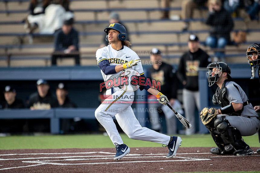 Michigan Wolverines first baseman Jordan Brewer (22) hits a 4th inning 2 run home run against the Western Michigan Broncos on March 18, 2019 in the NCAA baseball game at Ray Fisher Stadium in Ann Arbor, Michigan. Michigan defeated Western Michigan 12-5. (Andrew Woolley/Four Seam Images)