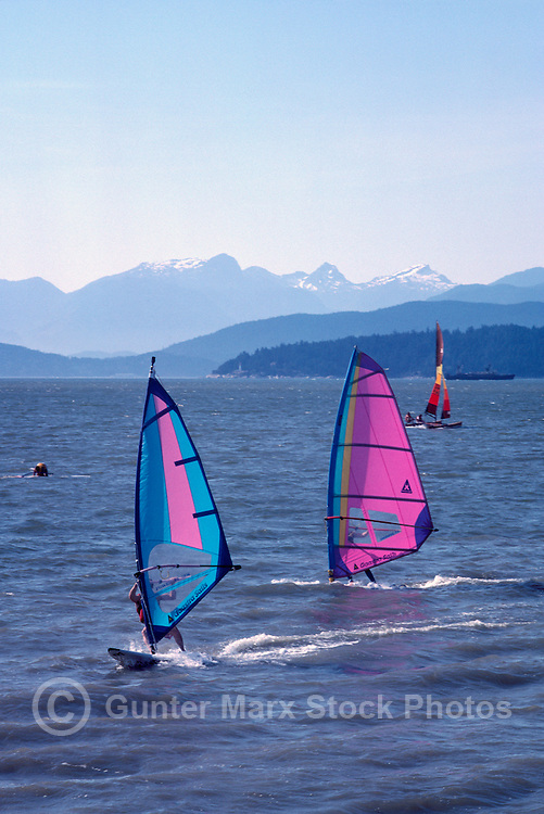 Windsurfing at Jericho Beach in English Bay, Vancouver, BC, British Columbia, Canada - Coast Mountains in background