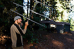 Mountain Lion (Puma concolor) biologist, Paul Houghtaling, using telemetry to track mother and cubs near houses, Santa Cruz Puma Project, Santa Cruz, Monterey Bay, California