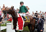 8 August 2009: GIO PONTI,  jockey Ramon A. Dominguez and trainer Christophe Clement in the winner's circle after winning the 27th running of the G1 Arlington Million at Arlington Park in Arlington Heights, Illinois.