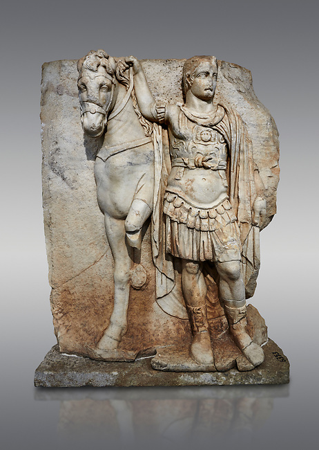 Roman Sebasteion relief sculpture of  an Imperial prince as Diokouros, Aphrodisias Museum, Aphrodisias, Turkey. <br /> <br /> An imperial youth wearing a military cloak and cuirass of a commander holds the reins of hios horse. This panel is next to a Claudius panel so is probably of Britanicus or Nero the emperors son and intended successor