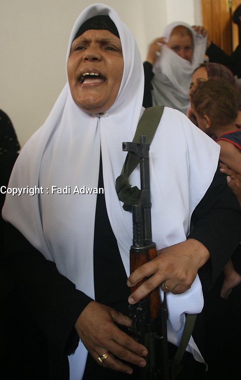 Palestinian relatives react as the mourners carry a body of one of 6 Hamas militants were killed by an Israeli air strike, out of the family house during their funeral in Buraije refugee camp, Centeral Gaza Strip, Tuesday, Aug. 21, 2007. (FADY ADWAN)