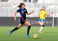 ORLANDO, FL - FEBRUARY 21: Alex Morgan #13 of the USWNT dribbles during a game between Brazil and USWNT at Exploria Stadium on February 21, 2021 in Orlando, Florida.