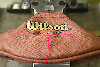 20 January 2005: A laser is used to line up stamps that apply the AFC and NFC champion team names on footballs for the Super Bowl at the Wilson football factory Thursday January 20, 2005 in Ada, Ohio.<br />