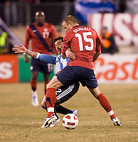 Jay DeMerit (15) of the United States fights for the ball with Ezequiel Lavezzi (22) of Argentina during an international friendly at New Meadowlands Stadium in East Rutherford, NJ.  The United States tied Argentina, 1-1.
