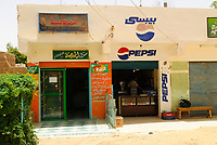 Small smart shop in downtown of the city of Al Qasr in Dakhla oasis, west of Egypt. Al Qasr is situated in the Dakhla oasis in the Lybian Desert in the West of Egypt. With a population of around 700, the town was built from Roman ruins and has narrow covered streets. There are 54 lintels, some dating from the Ottoman and Mamluk era which adorn the old houses, one of which dates to about 924 AD.