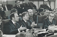 1969 FILE PHOTO - ARCHIVES -<br /> <br /> Prime Minister Pierre Trudeau; left; outlines the government's stand on making welfare payments directly to individuals; during the continuing talks on Canada's bread-and-butter issues which got under way in Ottawa yesterday. Jean Marchand; centre; sits contemplatively; but Quebec Premier Jean-Jacques Bertrand seems ill at ease. Bertrand was the only premier to oppose Trudeau's position<br /> <br /> PHOTO :  Jeff Goode - Toronto Star Archives - AQP