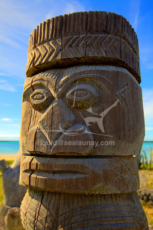 """Detail of the monument in memories of the missionaries at Vao on the Isle of pines, New Caledonia..The Isle of Pines (French: Île des Pins; Kanak name: Kunyié) is an island located in the Pacific Ocean, in the archipelago of New Caledonia, an overseas territory of France. The island is part of the commune (municipality) of L'Île-des-Pins, in the South Province of New Caledonia. The Isle of Pines is often nicknamed l'île la plus proche du paradis (""""the closest island to Paradise"""") and is famous for snorkeling and scuba diving in and around its colorful lagoon. Many species of tropical fish and corals can be seen in the transparent water..The island is located around [show location on an interactive map] 22°37?S 167°29?E / 22.617°S 167.483°E / -22.617; 167.483Coordinates: 22°37?S 167°29?E / 22.617°S 167.483°E / -22.617; 167.483 and measures 15 km (9 miles) by 13 km (8 miles). It lies southeast of Grande Terre, New Caledonia's main island and is approximately 100 kilometres south-east of the capital Noumea. There is one airport (code ILP) with a 1,097-meter (3,600 ft) runway. The Isle of Pines is surrounded by the New Caledonia Barrier Reef..The inhabitants of the island are mainly native Melanesian Kanaks and the population is approximately 2,000 (estimated 2006) (1989 population 1,465)..The island is rich with animal life and is home to many unique creatures such as the Crested Gecko Rhacodactylus ciliatus and the world's largest gecko Rhacodactylus leachianus..The pic Nga is the island's highest point, at 262 meters (860 ft) elevation..The island was first discovered by Captain James Cook in 1774 on his second voyage to New Zealand. Captain Cook gave the island its name after seeing the tall native pines (Araucaria columnaris). It is said he never actually disembarked onto the island but as he saw signs of inhabitance (smoke) assumed it was inhabited. In the 1840s both Protestant and Catholic missionaries arrived, along with merchants seeking sandalwood..The French"""
