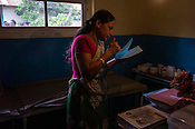 A local health clinic worker looks through the papers in the clinic in Eskdale Tea Estate in Nuwareliya in Central Sri Lanka.  Photo: Sanjit Das/Panos