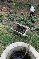 KENYA, County Kakamega, Bukura, village Eshibeye, small biogas plant at milk cow farm, the remains of fermentation are used as compost on the farm to improve the soil quality, field with black nightshade (Solanum nigrum) / KENIA, kleine Biogasanlage auf einer Milchkuhfarm,  die Gaerreste werden als Kompost auf den Feldern zur Bodenverbesserung verwendet