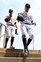 Montgomery Biscuits outfielder Taylor Motter (10) enters the dugout followed by outfielder Joey Rickard (7) during a game against the Mississippi Braves on April 22, 2014 at Riverwalk Stadium in Montgomery, Alabama.  Mississippi defeated Montgomery 6-2.  (Mike Janes/Four Seam Images)