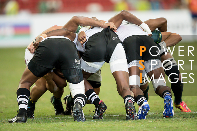 Fiji players form a scrum during the match Fiji vs South Africa, Day 2 of the HSBC Singapore Rugby Sevens as part of the World Rugby HSBC World Rugby Sevens Series 2016-17 at the National Stadium on 16 April 2017 in Singapore. Photo by Victor Fraile / Power Sport Images