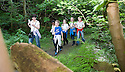 21/05/2010   Copyright  Pic : James Stewart.012_helix_green_team_walk  .::  HELIX PROJECT ::  GREENSPACE :: KIDS FROM THE HELIX GREEN TEAM ARE SHOWN AROUND THE EAST PART OF THE HELIX WOODLAND GREENSPACE BY STEP FORTH'S BARBARA MCCONNELL  ::..