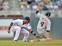 29 September 2012: Minnesota Twins shortstop Pedro Florimon manages to get the ball a split second late as Detroit Tigers second baseman Omar Infante slides safely into second with his 15th stolen base of the season in the top of the 9th inning against the Minnesota Twins at Target Field in Minneapolis, MN. The Tigers defeated the Twins 6-4 in the second game of their 3-game series. Mandatory Credit: Ed Wolfstein Photo
