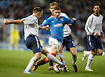 Fraser Aird running through a line of defenders