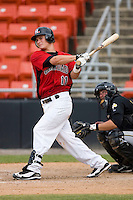 Matt West #11 of the Hickory Crawdads follows through on a home run in the 9th inning at L.P. Frans Stadium June 21, 2009 in Hickory, North Carolina. (Photo by Brian Westerholt / Four Seam Images)