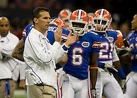 01 January 2010:  Florida head coach Urban Meyer claps during warm-ups before the game against Cincinnati during Sugar Bowl at the SuperDome in New Orleans, Louisiana.