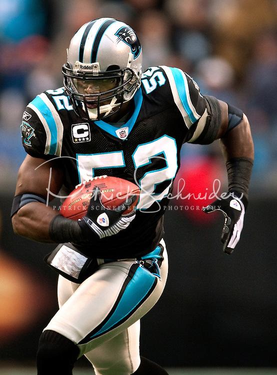 Carolina Panthers linebacker Jon Beason (52) runs the ball against the Denver Broncos during an NFL football game at Bank of America Stadium in Charlotte, NC.