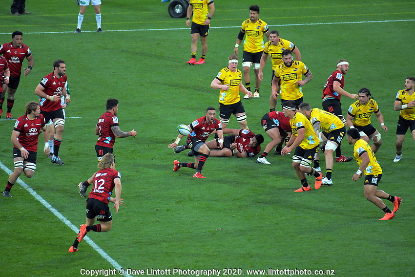 Bryn Hall passes to Codie Taylor during the Super Rugby Aotearoa match between the Hurricanes and Crusaders at Sky Stadium in Wellington, New Zealand on Saturday, 21 June 2020. Photo: Dave Lintott / lintottphoto.co.nz