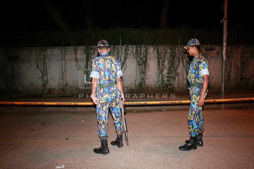 Bangladeshi police stands guard in front of the shooting spot where Italian citizen Tavela Cissera, 50, shoot by unknown assailants at Gulshan-2, Dhaka.   On September 28, 2015, evening, Italian citizen was shot to dead by unknown assailants in the capital's Gulshan diplomatic zone, Dhaka, Bangladesh.