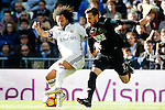 Real Madrid's Marcelo Vieira (l) and Granada CF's Tito Roman during La Liga match. January 7,2016. (ALTERPHOTOS/Acero)