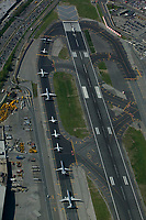 aerial photograph of a backup of aircraft waiting to depart runway 4 at the LaGuardia airport, Queens, New York