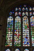 UK, England, Cambridge.  King's College Chapel, Stained Glass showing (lower left) Eve Tempted by the Apple.