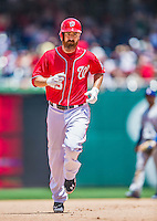 31 May 2014: Washington Nationals first baseman Adam LaRoche rounds the bases after hitting a 3-run homer in the 4th inning against the Texas Rangers at Nationals Park in Washington, DC. The Nationals defeated the Rangers 10-2, notching a second win of their 3-game inter-league series. Mandatory Credit: Ed Wolfstein Photo *** RAW (NEF) Image File Available ***