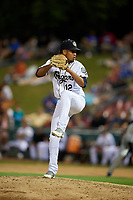 Kane County Cougars relief pitcher Juan Torres (12) delivers a pitch during a game against the West Michigan Whitecaps on July 19, 2018 at Northwestern Medicine Field in Geneva, Illinois.  Kane County defeated West Michigan 8-5.  (Mike Janes/Four Seam Images)