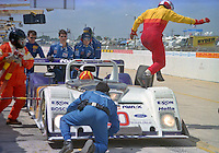The #20 Riley & Scott Mark III of Elliott Forbes-Robinson, John Schneider, John Paul, Jr. and Rob Dyson makes a pit stop during the 12 Hours of Sebring, Sebring, FL, March 15, 1997.  (Photo by Brian Cleary/www.bcpix.com)