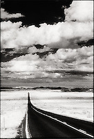 Endless road through desert and open sky<br />