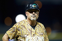 Down East Wood Ducks manager Spike Owen (11) coaches third base during the game against the Winston-Salem Dash at BB&T Ballpark on May 12, 2018 in Winston-Salem, North Carolina. The Wood Ducks defeated the Dash 7-5. (Brian Westerholt/Four Seam Images)