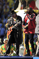 Carlos Santana performs during the closing ceremony with Wyclef Jean