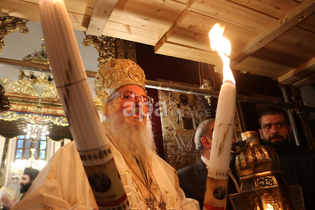 Head of the Greek Orthodox church in Bethlehem Bishop Theofilactos attends the Holy Fire ceremony in Bethlehem's Church of the Nativity, in the Israeli-occupied West Bank, on May 1, 2021, on the eve of Orthodox Easter. Photo by Mosab Shawer