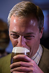 © Joel Goodman - 07973 332324 . 24/04/2014 . Knutsford , UK . UKIP leader NIGEL FARAGE in The Angel pub in Knutsford . Farage has come under fire in recent days over a controversial UKIP billboard campaign . Photo credit : Joel Goodman