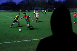 Congleton Town 1 Coventry United 1 (Pens 4-3), 19/12/2020. Ivy Gardens, FA Vase Third Round. A spectator watching the second-half action as Congleton Town (white) play Coventry United. The home team were founded in 1901 and played in the North West Counties League Premier Division. They defeated their opponents from the Midland League Premier Division 4-3 on penalties after the match ended 1-1, watched by 300 spectators, the maximum permitted under Covid-19 restrictions. Photo by Colin McPherson.