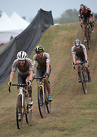 A line of riders descends a hill Wednesday, Oct. 13, 2021, as they compete in the Union Cycliste Internationale Cyclo-cross World Cup at Centennial Park in Fayetteville. The city was one of 16 sites around the globe to hold a world cup event this year for Union Cycliste Internationale, known as International Cycling Union in the United States. Fayetteville will host the UCI World Championships at Centennial Park Jan. 28-30. Visit nwaonline.com/211014Daily/ for today's photo gallery.<br /> (NWA Democrat-Gazette/Andy Shupe)