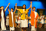Education public school Grade 6 play curtain call  students of differing heights and stage of development