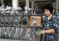 A worker loads and transports bicycle frames at the Shanghai Forever Bicycle Factory (SFBF) in Shanghai, China. Despite the government's efforts to encourage automobile ownership in recent years, the bicycle remains the most popular mode of transportation for China's masses. The SFBF, it's products once a must have and a symbol of status for every Chinese family, are now supplying bicycles to countries around the world. It has seen it's sales increase 59% percent in the past year to 876 million yuan (euro 89.36 million)..21-APR-04