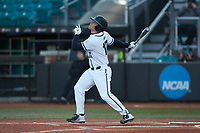 Coastal Carolina Chanticleers pinch-hitter Jared Johnson (17) follows through on his swing against the Illinois Fighting Illini  at Springs Brooks Stadium on February 22, 2020 in Conway, South Carolina. The Fighting Illini defeated the Chanticleers 5-2. (Brian Westerholt/Four Seam Images)