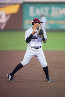 Idaho Falls Chukars third baseman Julio Gonzalez (12) prepares to make a throw to first base during a Pioneer League game against the Billings Mustangs at Melaleuca Field on August 22, 2018 in Idaho Falls, Idaho. The Idaho Falls Chukars defeated the Billings Mustangs by a score of 5-3. (Zachary Lucy/Four Seam Images)