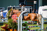 NZL-Nell Dempsey rides Merlyn Little Secret. Class 26: Pony 1.05m Ranking Class. 2021 NZL-Easter Jumping Festival presented by McIntosh Global Equestrian and Equestrian Entries. NEC Taupo. Saturday 3 April. Copyright Photo: Libby Law Photography