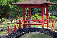 Two young girls under pagoda bridge at Liliuokalani park, Hilo, Big island