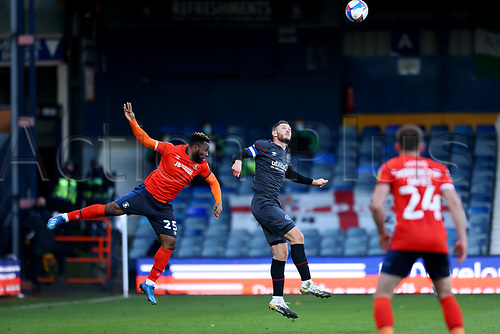 31st October 2020; Kenilworth Road, Luton, Bedfordshire, England; English Football League Championship Football, Luton Town versus Brentford; Vitaly Fosu of Brentford competes for a header with Kazenga LuaLua of Luton Town