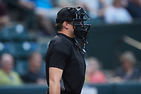 Home plate umpire Dylan Bradley works the High-A East game between the Greensboro Grasshoppers and the Winston-Salem Dash at Truist Stadium on August 13, 2021 in Winston-Salem, North Carolina. (Brian Westerholt/Four Seam Images)