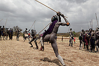 Bugu has a dispute over a woman and challenges his rival to a Donga (stick fight)  Bugu is the one that is getting stuff out of his hut...Contacts:.Steve Turner... steveturner@originsafari.info.+ 254 722 707521..Robel Pedros Local guide for Surma.+ 251 911 423112.Daniel Tesfaye  +251 912 029726