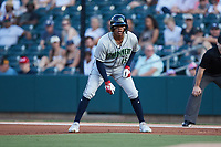 Cristian Pache (15) of the Gwinnett Stripers takes his lead off of first base against the Charlotte Knights at Truist Field on July 17, 2021 in Charlotte, North Carolina. (Brian Westerholt/Four Seam Images)