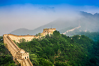 The Great Wall and mountains under morning mist, in China.