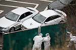 © Joel Goodman - 07973 332324 . 03/01/2017. Huddersfield, UK. Forensic scenes of crime officers erect a screen to block the view of a bullet riddled silver Audi car at the slip road at Junction 24 of the M62 motorway in Huddersfield . West Yorkshire police have announced a man has died following the discharge of a police firearm , during what they describe as a pre-planned operation , yesterday evening (2nd January 2017) . Photo credit : Joel Goodman